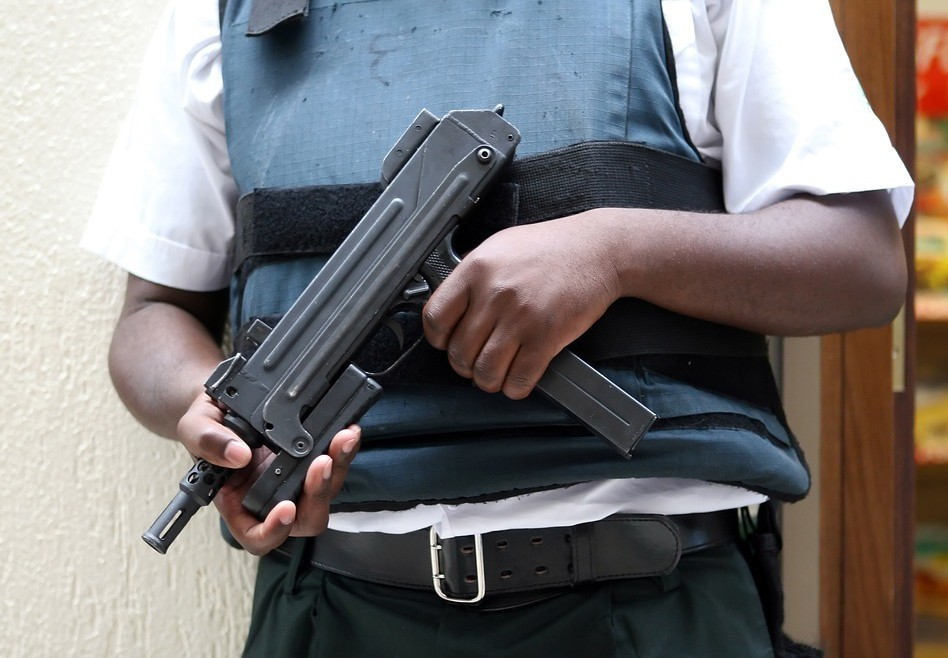 Armed police man